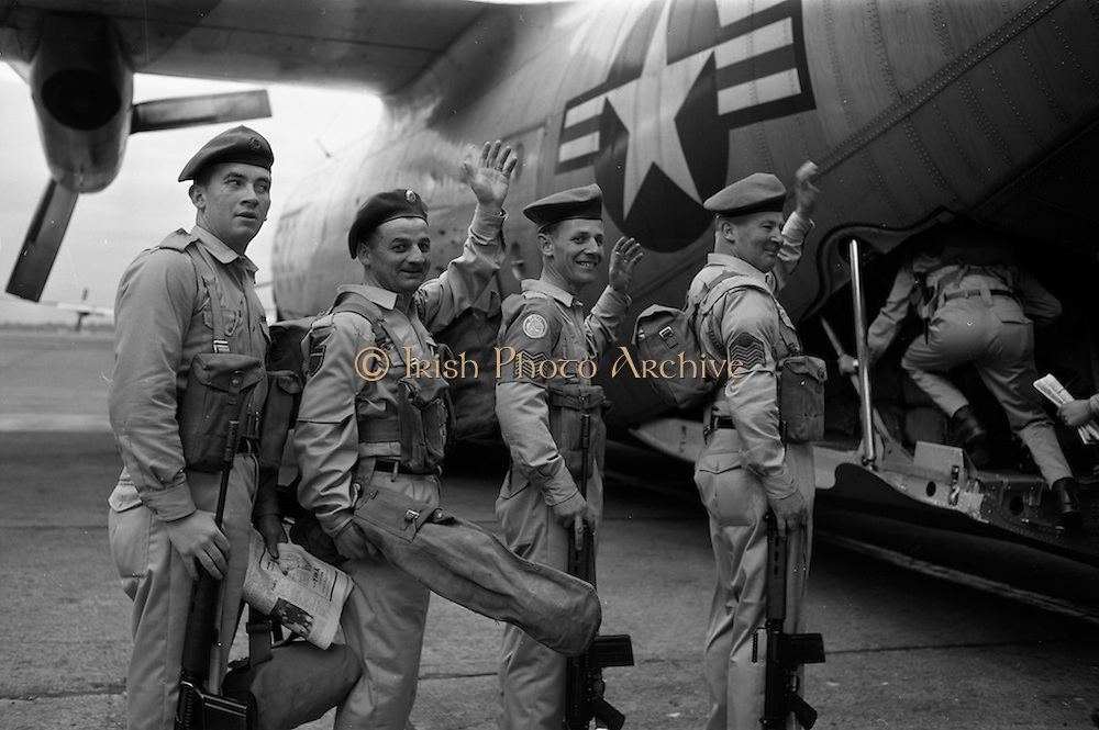09/04/1964<br /> 04/09/1964<br /> 09 April 1964<br /> Irish U.N. advance party leave for Cyprus. An advance party of 60 Irish troops of the 40th Battalion leaving Dublin Airport by U.S. Airforce plane for Nicosia Airport, the rest of the unit would fly out two weeks later. Picture shows (l-r): Signalman Brown; Private McInerney (Limerick); Sgt. Michael Higgins (Cork) and C/S William McLoughlin (Cork) giving a wave to the camera before boarding the aircraft.