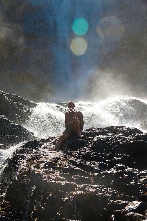 Naturalist and guide Richard Costin bathes in the freshwater at Turtle Falls in Dugong Bay on the Kimberley coast at the end of the wet season.