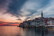 As the sun sets on the Adriatic, the lights begin to shine in the town of Rovinj, in Croatia.