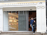 Victoria Beckham new store due to open today in London's Mayfair.<br /> <br /> photo shows: The store's minimalist shop front was unveiled this morning as workers put the finishing touches to the store ahead of its opening later today <br /> ©Exclusivepix