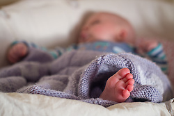 Embargoed to 0001 Sunday June 18 File photo dated 24/1/2016 of a baby sleeping in a basket. One in four new fathers are missing out on paternity leave and pay mainly because they are self-employed, a new study shows.