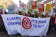 Demonstrators begin their march from Lincoln's Inn Fields at the start of the Time To Act, national climate march organised by Campaign Against Climate Change in London, England on March 7, 2015