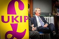 UK Independence Party leader Nigel Farage talks to the press during European election campaigning on May 9, 2014 at The Corn Exchange, Edinburgh.