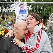 Lennon's family at the scene L to R : Karen Pearson (Grandmother, Leanne's mother) and Leanne Tolland ( Lennon's mum). Flowers and tributes to Lennon Tolland who was killed by a van yesterday in Dalness Street, Tollcross, Glasgow. Picture Robert Perry for The Herald and  Evening Times 13th Sept 3rd July 2016