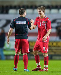 SWANSEA, ENGLAND - Friday, September 4, 2009: Wales' Aaron Ramsey celebrates with team-mate Darcy Blake after their side's 2-1 victory over Italy during the UEFA Under 21 Championship Qualifying Group 3 match at the Liberty Stadium. (Photo by David Rawcliffe/Propaganda)