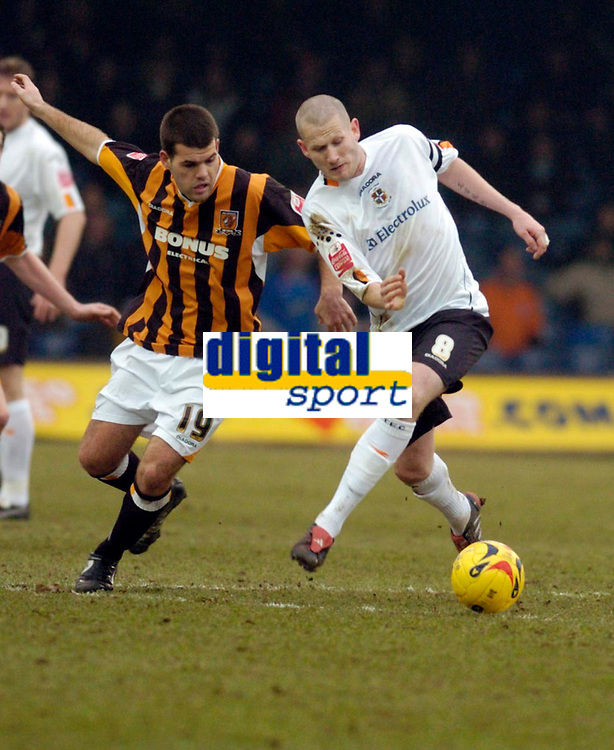 Photo: Leigh Quinnell.<br /> Luton Town v Hull City. Coca Cola Championship. 04/02/2006. Hulls John Welsh challenges Lutons Kevin Nicholls.
