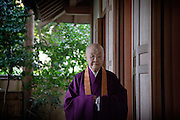 (Eng) Kyoto - 10th of November 2009 - The writer and nun Jakucho Setouchi, 87,  in the garden of her property in the Sagano district.<br /> After the construction of the house in 1974, she told her friends that she didn't want any gift, except trees or plants. She also let them choose the place in the garden. Now many of them are dead, but she can keep thinking about them with those trees.<br /> <br /> (Fr) Kyoto - 10 novembre 2009 - L'écrivain et nonne Jakucho Setouchi , 87 ans, dans le jardin de sa propriété du quartier de Sagano. Lors de l'inauguration de sa maison en 1974, Jakucho demanda a ses amis d'amener un arbre ou une plante, plutot que des cadeaux. Elle leur laissa choisir l'emplacememnt dans le jardin. Aujourd'hui beaucoup sont morts, mais Jakucho garde ainsi leur souvenir pres d'elle.