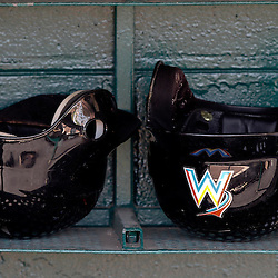 March 26, 2012; Lakeland, FL, USA; A detail of Miami Marlins batting helmets in the dugout before a spring training game against the Detroit Tigers at Joker Marchant Stadium. Mandatory Credit: Derick E. Hingle-US PRESSWIRE