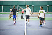 College Park, Maryland - December 19, 2013: Francis Tiafoe, 15, left, with other students at the Junior Tennis Champions Center in College Park, Maryland December 19, 2013<br /> <br /> <br /> CREDIT: Matt Roth for The New York Times<br /> Assignment ID: