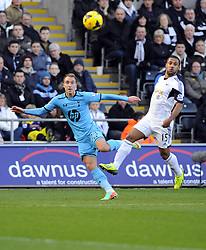 Tottenham Hotspur's Christian Eriksen crosses  - Photo mandatory by-line: Joe Meredith/JMP - Tel: Mobile: 07966 386802 19/01/2014 - SPORT - FOOTBALL - Liberty Stadium - Swansea - Swansea City v Tottenham Hotspur - Barclays Premier League