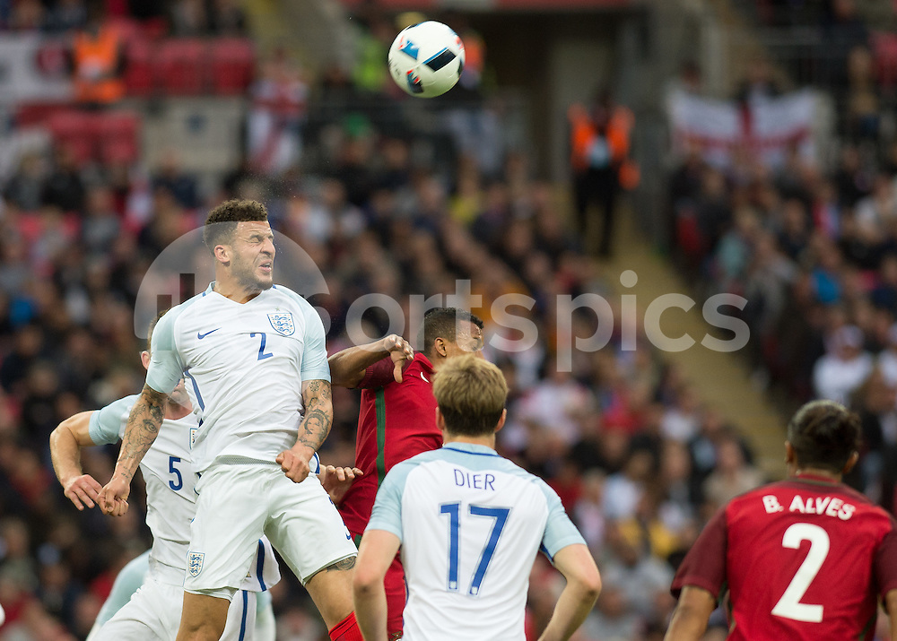 Kyle Walker of England heads the ball clear during the International Friendly match between England and Portugal at Wembley Stadium, London, England on 2 June 2016. Photo by Vince  Mignott.