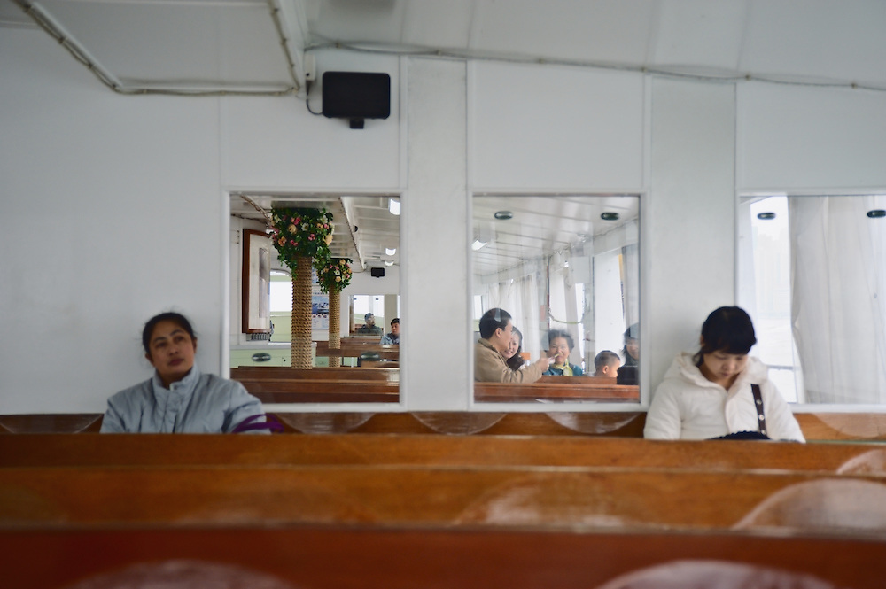 Passengers aboard Star Ferry from Hong Hum to Central, Hong Kong