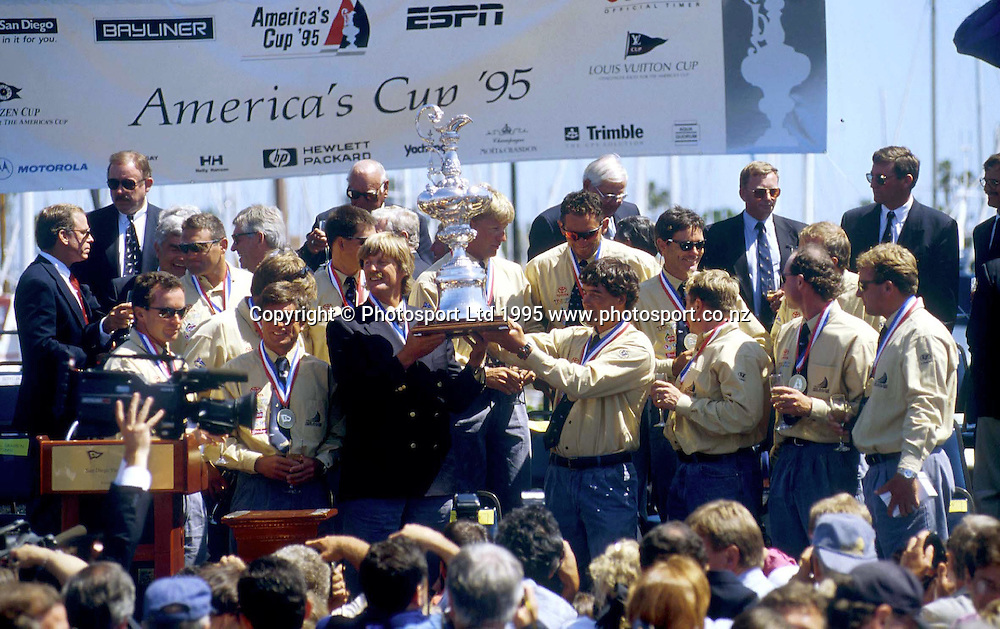 Sir Peter Blake and Team New Zealand at the prize giving  after winning the America's Cup, Sandiego, USA. 1995. Photo: PHOTOSPORT<br />