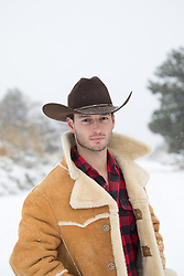 Portrait of a handsome cowboy in Winter