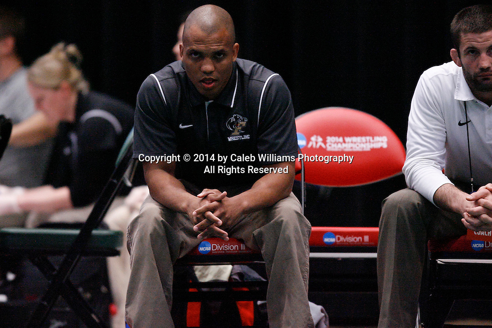 NCAA Division III Wrestling National Championships<br /> Session II<br /> <br /> CEDAR RAPIDS, Iowa (Feb. 14, 2014) -- Ferrum Asst. Coach Brandon Bradley watches action between Ferrum's Logan Meister and Mount Union's Bryant Roby at the 2014 NCAA Div. III Wrestling National Championships. Meister won the match 6-1 in sudden victory 1.