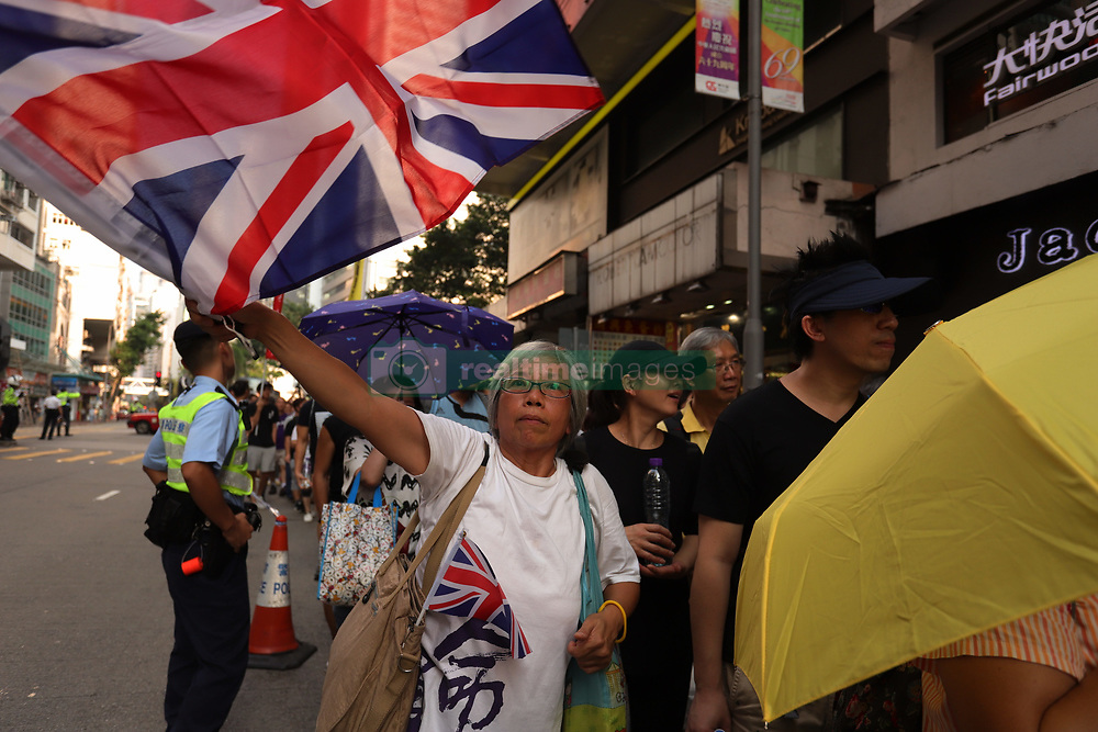 October 1, 2018 - Hong Kong, CHINA - A woman waves Union Jack during annual anti-China rally on the national day. Today marks the 69th anniversary of the founding of PRC, thousand of Hong Kong citizens marched for Hong Kong independence and political freedom. Oct-1,2018 Hong Kong.ZUMA/Liau Chung-ren (Credit Image: © Liau Chung-ren/ZUMA Wire)