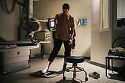 "BIRMINGHAM, AL – FEBRUARY 1, 2019:  Warren ""Azad"" Stoddard, 24, stands for x-rays that will reveal a bullet fragment lodged in his foot, received while fighting ISIS alongside Kurdish YPG forces in Syria. CREDIT: Bob Miller for The New York Times<br /> <br /> In the war against ISIS, American volunteers have joined the ranks of a Syrian militia, operating independently of the United States. Until recently, the predominantly Kurdish YPG forces had enjoyed air and ground support from the United States, but now that US is officially leaving, the remaining American volunteers face uncertain odds. <br /> <br /> Warren Stoddard, 24, comes from a long line of military veterans and active service members. So when a knee injury prevented him from enlisting in the Marines in 2016, he reached out to a YPG liaison on Facebook to declare his interest in volunteering. ""I always wanted to serve, to do something worthwhile and to take part in some historical event,"" Stoddard said. ""And I cared about the Kurdish cause."" Two years later, as the Turkish invasion placed added pressure on the predominantly Kurdish YPG, Stoddard finally received an invitation to join and purchased his own one way ticket. Six months later, while engaging an ISIS stronghold alongside his YPG unit, Stoddard caught bullet fragments in his his upper thigh and foot, where a small fragment is still lodged."