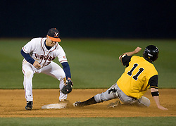 Towson OF Kevin Collins (11) beats the tag by Virginia Cavaliers INF Greg Miclat (2) while stealing second.  The #15 ranked Virginia Cavaliers baseball team fell to the Towson Tigers 7-6 at the University of Virginia's Davenport Field in Charlottesville, VA on April 2, 2008.