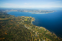 Aerial view of Royston, south of Courtenay with the Comox Bay and the Comox Peninsula and Goose Spit in the background.  Georgia Strait and the Coast Mountains in the distance.  Comox Valley, Vancouver Island, British Columbia, Canada.