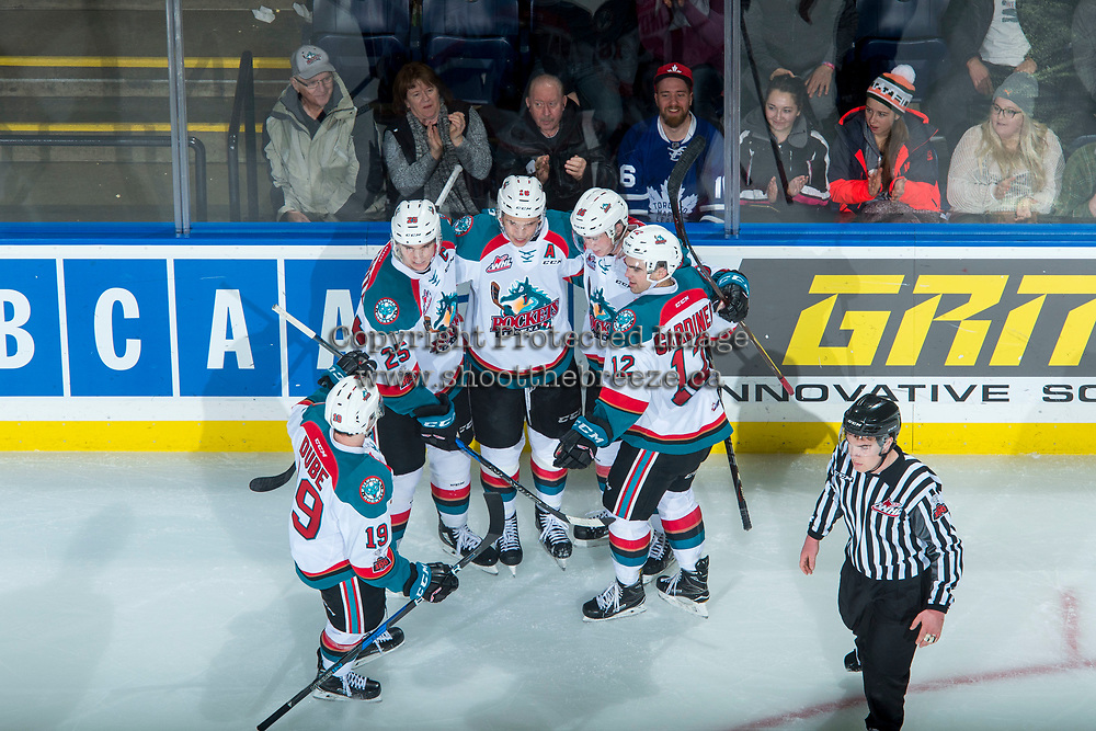 KELOWNA, CANADA - FEBRUARY 24:  Erik Gardiner #12, Dillon Dube #19, Cal Foote #25 Carsen Twarynski #18 and Kole Lind #16 of the Kelowna Rockets celebrate a third period goal against the Kamloops Blazers on February 24, 2018 at Prospera Place in Kelowna, British Columbia, Canada.  (Photo by Marissa Baecker/Shoot the Breeze)  *** Local Caption ***