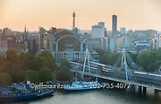 Sunset view of the Golden Jubilee Bridges and London Charing Cross