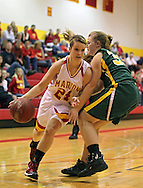 Marion's Dani Peyton (24) drives around Beckman's Mariah Hargrafen (33) during their game at Marion High School, 675 South 15th Street, in Marion, on Tuesday evening, November 22, 2011. (Stephen Mally/Freelance)