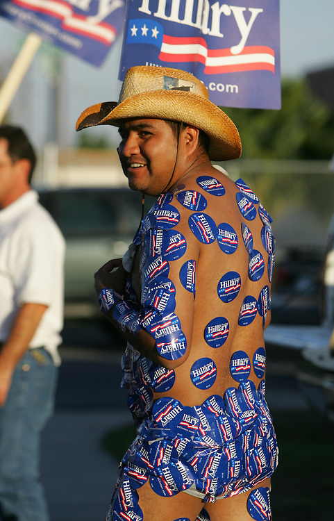 McAllen, TX - 4 Mar 2008 -.Felipe Bravo is dressed only in only underwear and Hillary Clinton stickers as he campaigns across the street from the Palmer Pavillion in McAllen on Tuesday evening.  Bravo, a resident alien waiting to take his citizenship test, said he and his girlfriend have been following Hillary's campaign across the country..Photo by Alex Jones / ajones@themonitor.com