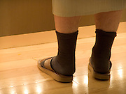 man standing wearing slippers Japan