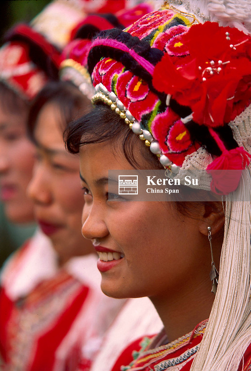 Bai girls in traditional costume and hair dress, Dali, Yunnan Province, China