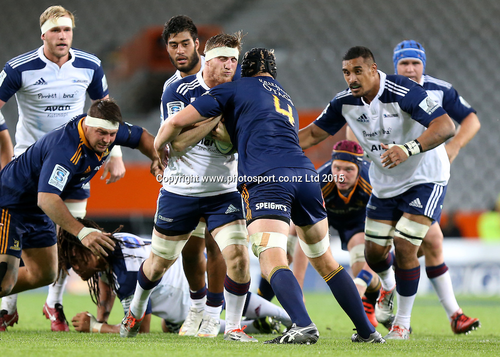 Blues Brendon O'Connor in the tackle of Highlanders Mark Reddish during the Super 15 rugby match between the Highlanders and the Blues at Forsyth Barr Stadium, Dunedin, Saturday, April 18, 2015. Photo: Dianne Manson / www.photosport.co.nz