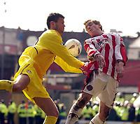 Sheffield United v Leeds United, AXA FA Cup, Brammall Lane, Sheffield. 09/03/2003.<br />Leeds' Eirik Bakke (L) and Sheffield's Rob Kozluk challenge for possession.<br />Photo. Jed Wee, Digitalsport