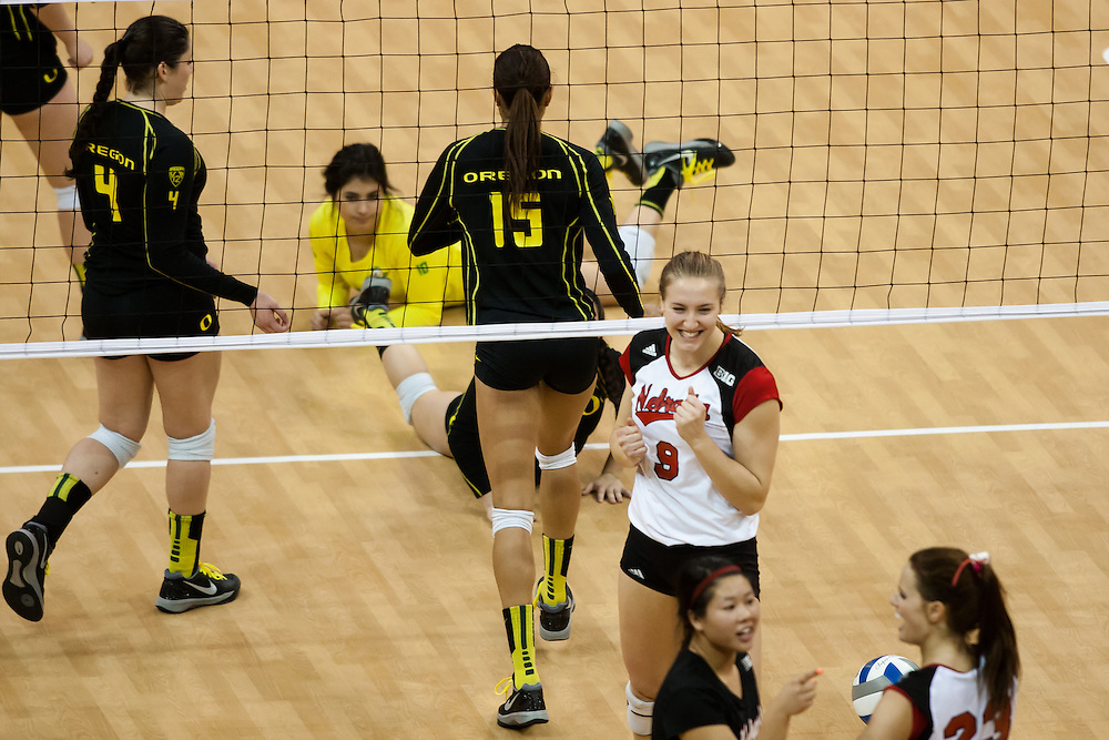 December 7, 2013: Cecilia Hall (9) of the Nebraska Cornhuskers hits scores against the Oregon Ducks. Nebraska sweeps Oregon in the second round of the NCAA Volleyball Championships at the Devaney Sports Center in Lincoln, Nebraska.
