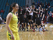 Stanford Cardinal teams storms the court after upsetting the Oregon Ducks in the  championship game of the Pac-12 Conference women's basketball tournament Sunday, Mar. 10, 2019 in Las Vegas.  Stanford defeated Oregon 64-57. (Gerome Wright/Image of Sport)