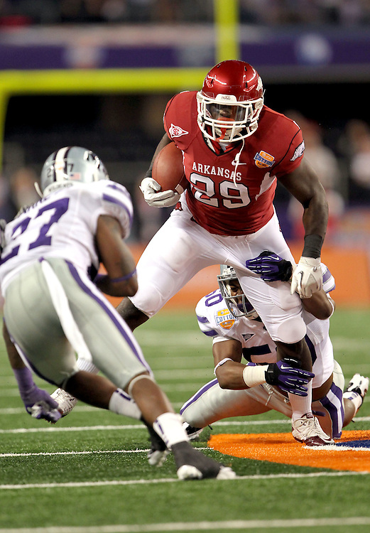 Arkansas running back Broderick Green (29) drags Kansas State linebacker Tre Walker (50) on his way to a first down before being tackled during the 2012 AT&T Cotton Bowl game at Cowboy Stadium in Arlington, Tx on Jan 6th, 2012 .