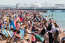 © Licensed to London News Pictures. 08/05/2016. Brighton, UK. Thousands of people take to the beach in Brighton to sunbathe as temperatures reach 22C down the South Coast. Photo credit: Hugo Michiels/LNP