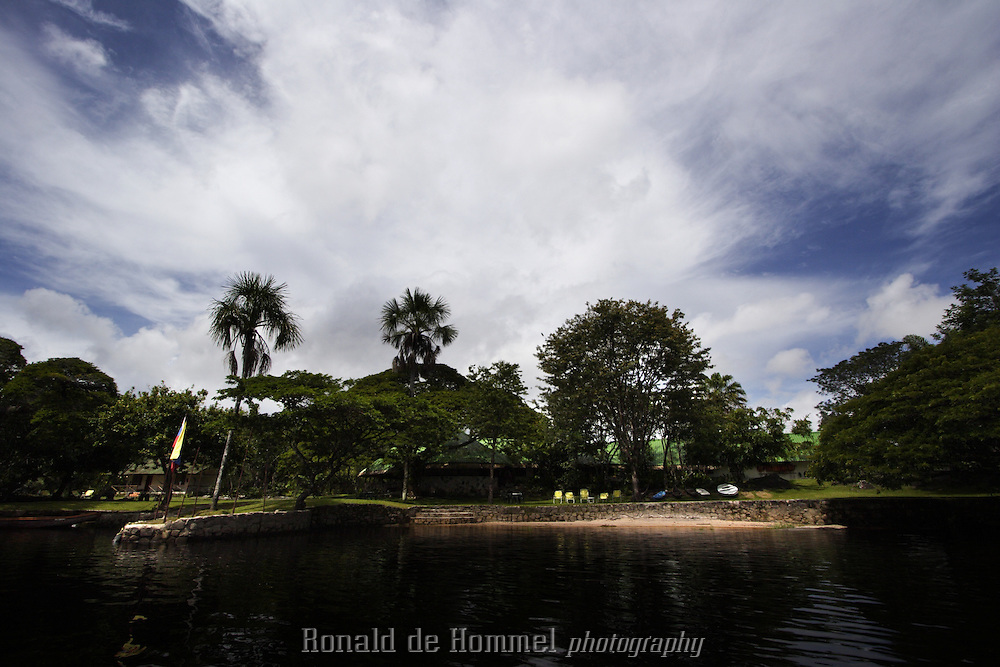 Canaima, Venezuela. Ucaima, the camp of Jungle Rudy. The Dutchman Rudolph Truffino came to Canaima in the fifties and slowly built up a camp at the Canaima lagoon. It is now the most famous and the oldest tourist destination in the park. National park Canaima in Central Venezuela is considered one of the most impressive natural sceneries in the world. On the edge of the Amazon basin this tropical forest area is a myriad of waterways separated by dense jungle and tabletop mountains called Tepuis with vertical cliffs of over 1000m. It's home to the highest waterfall in the world. The Angel Falls,are located in the centre of the park and have a continuous drop of 1000m. The remote area can only be reached by air or water, but the rivers are difficult to negotiate because of dangerous currents and rapids. From Canaima village canoe trips are organised to the Angel falls. The trip at high speed takes many hours and an overnight stay at the base of the falls is necessary.