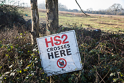 Harefield, UK. 21 January, 2020. A sign indicating the proposed path of the HS2 high-speed rail link at the Harvil Road site of the Save the Colne Valley Stop HS2 wildlife protection camp. Activists reoccupied the field behind the roadside camp on 18th January in order to seek to protect ancient woodland set to be destroyed by HS2.