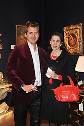 Artist GEORGE LEWIS and his wife ELIZABETH at a party to celebrate the publication of The irish Country House written by The Knight of Glin and James Peill with photographs by James Fennell, held at Christie's, King Street, London on 24th January 2011.