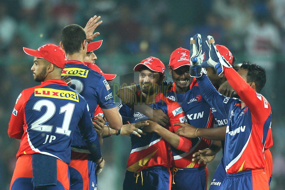 Shahbaz Nadeem of the Delhi Daredevils with his team players celebrates the wicket of Rohit Sharma captain of of the Mumbai Indians during match 21 of the Pepsi IPL 2015 (Indian Premier League) between The Delhi Daredevils and The Mumbai Indians held at the Ferozeshah Kotla stadium in Delhi, India on the 23rd April 2015.<br /> <br /> Photo by:  Deepak Malik / SPORTZPICS / IPL
