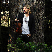 "David Garrett A virtuoso violinist who accidentally destroyed a very expensive violin. Apparently it wasn't a Strad but was worth over 1 million ($£?) Here he is with another very valuable violin (inside shots only) and a ""piece of sh*t"" in the outside pics. PHOTOGRAPHED AT SHEPERTON STUDIOS BY MARK CHILVERS 07811388780"