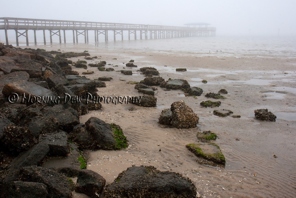 A view of the Safety Harbor pier at low tide, shrouded by an early morning fog. Safety Harbor, Florida