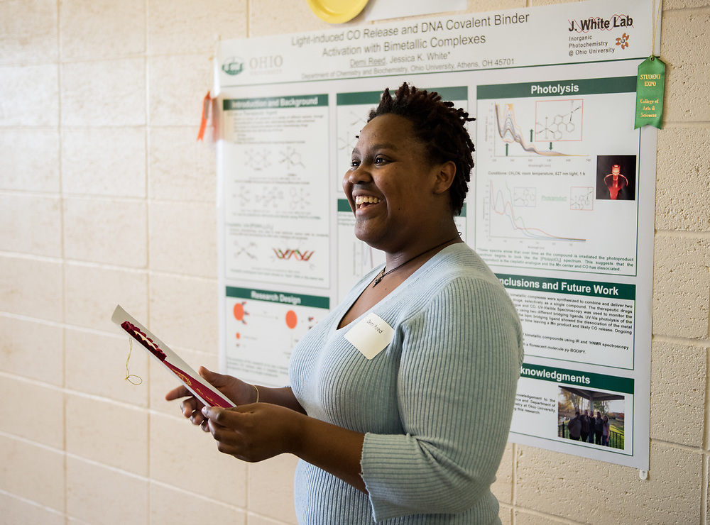 Demi Reed smiles after receiving a 2nd place award during the 2018 Student Research Expo.