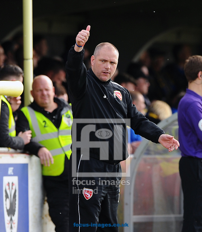 Manager Jim Bentley of Morecambe claps the fans during the Sky Bet League 2 match at the Cherry Red Records Stadium, Kingston<br /> Picture by Seb Daly/Focus Images Ltd +447738 614630<br /> 26/04/2014