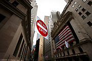 "Trouble on Wall Street. A sign with the text ""Do not enter"" in front of the NYSE Stock Exchange."