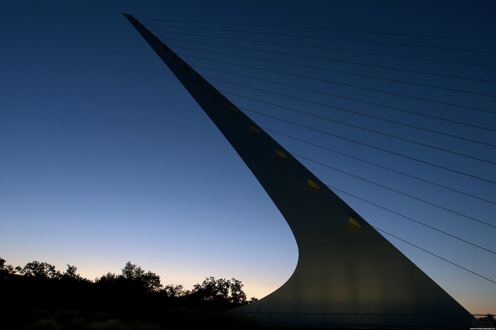 Architect Santiago Calatrava designed the Sundial Bridge in Redding. the $23 million footbridge It crosses the Sacramento River and never touches the water. ..The Sacramento River, California's largest river flowing 375 miles, from Mount Shasta in the north through the Central Valley and the Delta to San Francisco Bay, this river constitutes an irreplaceable resource to Northern California's ecology...Boating, fishing, camping and swimming on the Sacramento and its reservoirs attract more than 8 million visitors a year. ..The 21-mile stretch from Redding to Balls Ferry is perfect for scenic touring and shorter trips. For the adventuresome, the breath-taking 33-mile stretch between Balls Ferry and Red Bluff is your ticket...The Sundial Bridge is actually a working Sundial is 700 feet long, 23 feet wide and 217 feet high (pylon). The bridge weighs 3.2 million pounds (1,600 tons) and is composed of steel with galvanized steel cables. The deck materials are non-skid glass panels in steel framework with granite accents. The foundation consists of 115 tons of rebar, 1,900 cubic yards of concrete and a superstructure of 400 tons of steel. 200 tons of glass and granite were utilized in deck construction. The bridge contains 4,342 feet of cable and the pylon is 580 tons of steel.