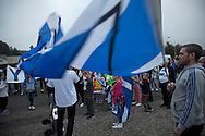 People listening to speeches at a spontaneous event to mobilise support for a pro-independence vote in the Craigmillar district of Edinburgh on the day of the independence referendum. Yes Scotland were campaigning for the country to leave the United Kingdom, whilst Better Together were campaigning for Scotland to remain in the UK. On the 18th of September 2014, the people of Scotland voted in a referendum to decide whether the country's union with England should continue or Scotland should become an independent nation once again and leave the United Kingdom.