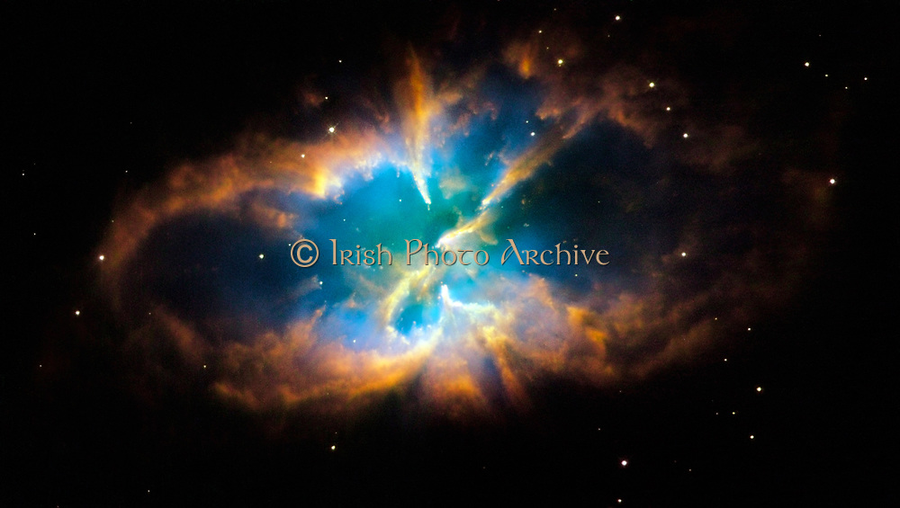 Planetary nebula NGC 2818 in the southern constellation of Pyxis (The Compass). Glowing layers and shell of gas were created when a star shed its outer layers into space after running out of nuclear fuel. Credit NASA. Science Astronomy