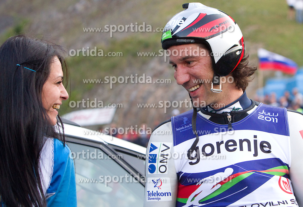 Primoz Peterka of Slovenia (R) with his wife Renata Bohinc Peterka after Ski Jumping Summer Continental Cup in Kranj and last jump of Primoz Peterka's career, one of the best ski jumpers in history, on July 2, 2011, in Kranj, Slovenia. (Photo by Vid Ponikvar / Sportida)