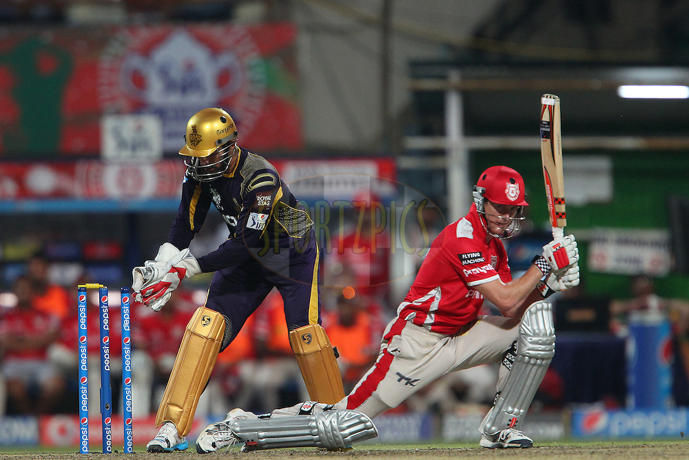 Robin Uthappa of the Kolkata Knight Riders tries to stump George Bailey of the Kings X1 Punjab during the first qualifier match (QF1) of the Pepsi Indian Premier League Season 2014 between the Kings XI Punjab and the Kolkata Knight Riders held at the Eden Gardens Cricket Stadium, Kolkata, India on the 28th May  2014<br /> <br /> Photo by Ron Gaunt / IPL / SPORTZPICS<br /> <br /> <br /> <br /> Image use subject to terms and conditions which can be found here:  http://sportzpics.photoshelter.com/gallery/Pepsi-IPL-Image-terms-and-conditions/G00004VW1IVJ.gB0/C0000TScjhBM6ikg