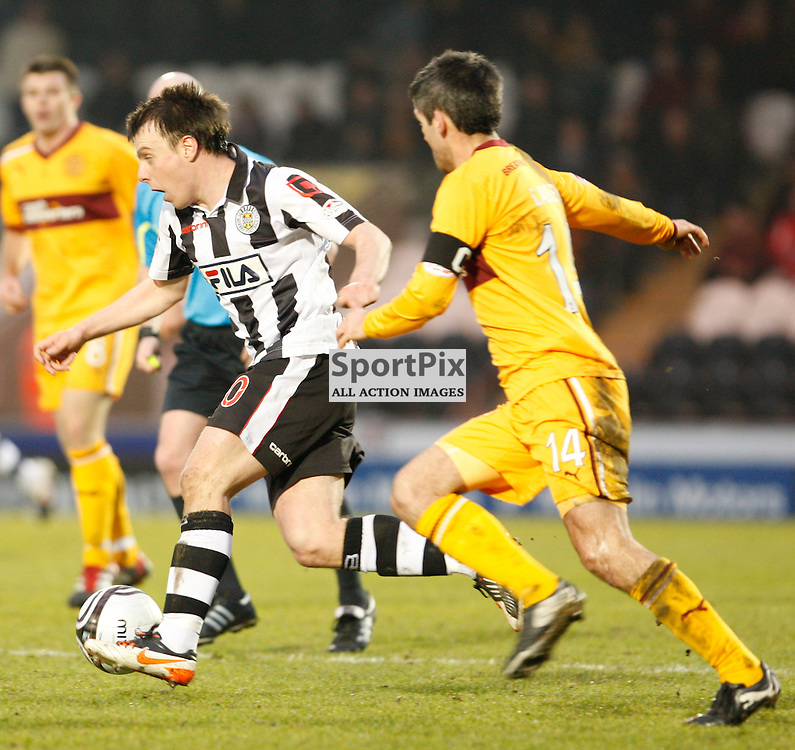 Clydesdale Bank Premier League, St Mirren v Motherwell 11.2.12. St Mirren's Paul McGowan tries to evade the challenge of Motherwell's Keith Lasley.